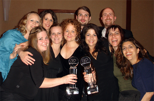 Best Autism Therapy Award group picture holding award